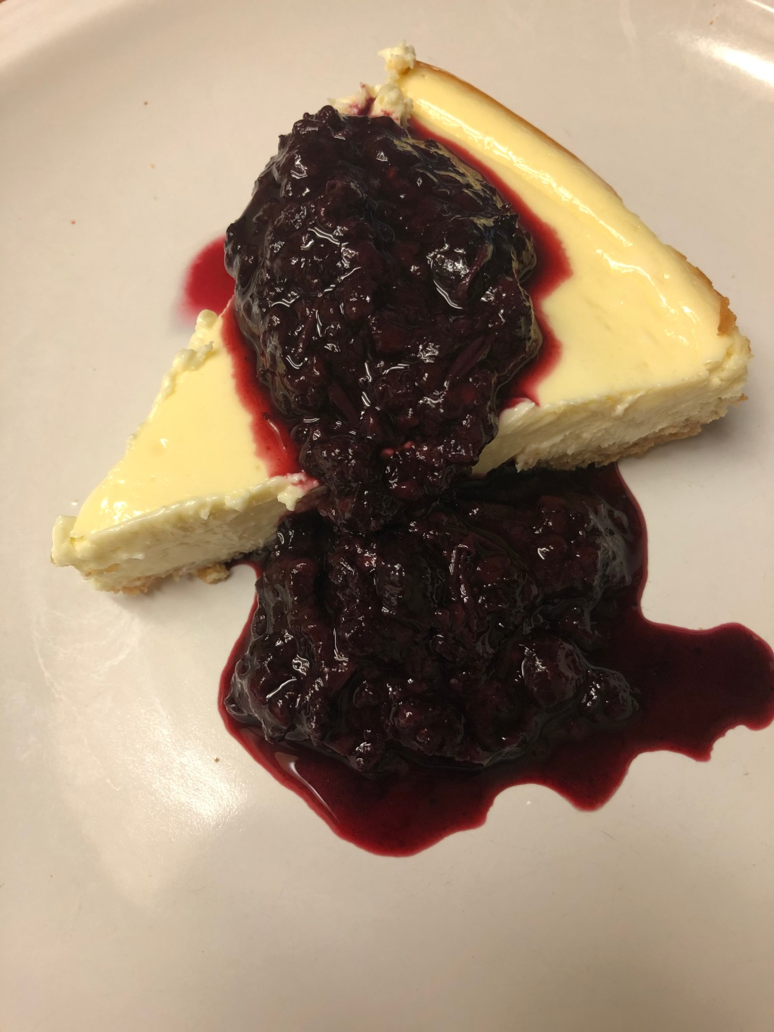 Homemade Cheesecake with Triple Berry Sauce